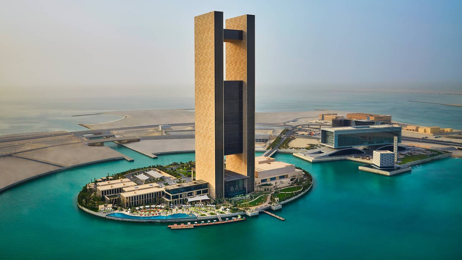 Four Seasons Hotel Bahrain Bay iconic tower on small oval-shaped reclaimed island, water surrounding