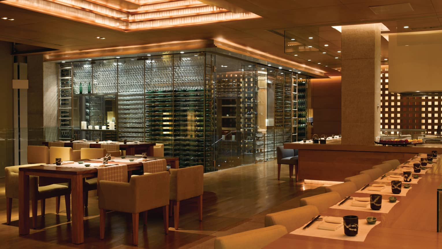 San Qi Upper Level dining room, large glass room with wine cellar racks, glasses