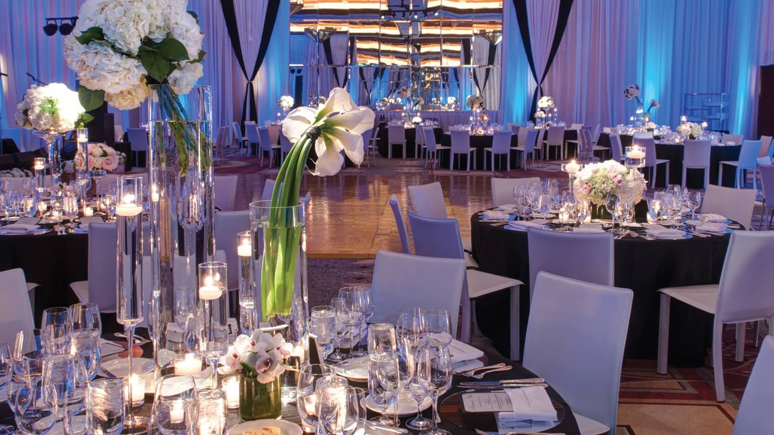 Pinnacle Ballroom wedding reception with candle-lit banquet tables, tall white flowers