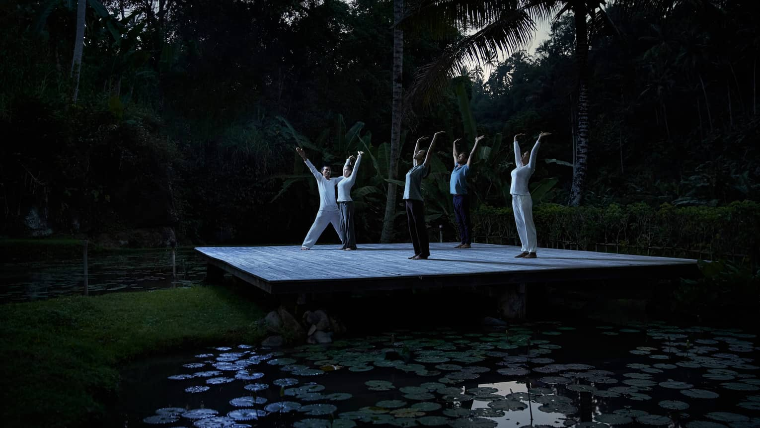 Group full moon purnama yoga near pond in Bali