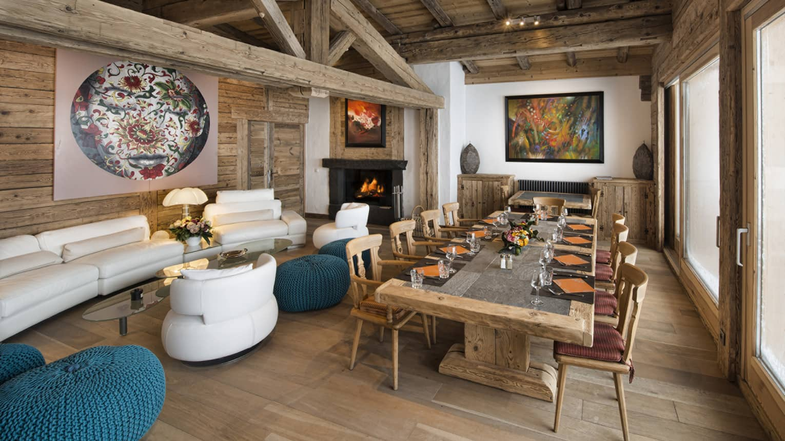 Ideal Suite lodge with modern white sofa, armchairs and long rustic wood dining table