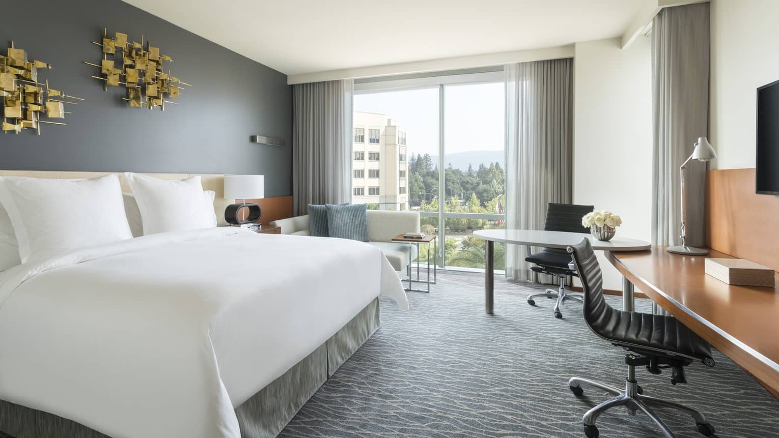 Premier Room Bed Under Modern Gold Art, Two Desks, Chaise By Floor To