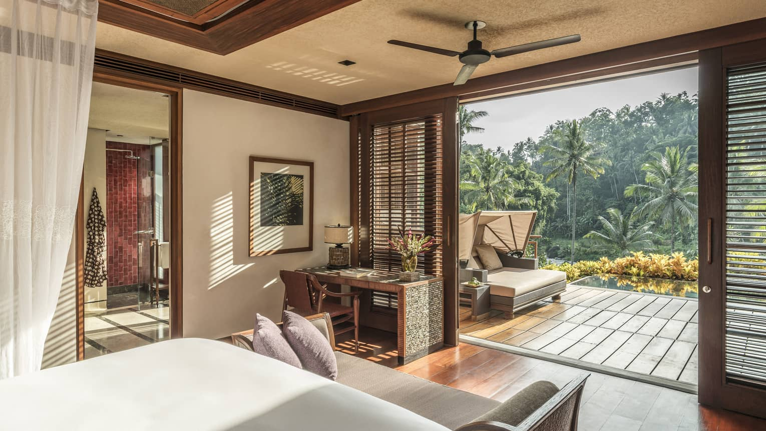 A scenic view from a spacious room overlooking a forest and river in Bali