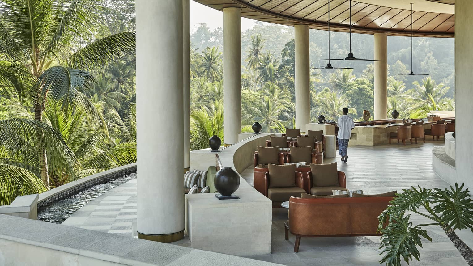 The lobby of the Four Seasons hotel in Bali, overlooking a vast forest