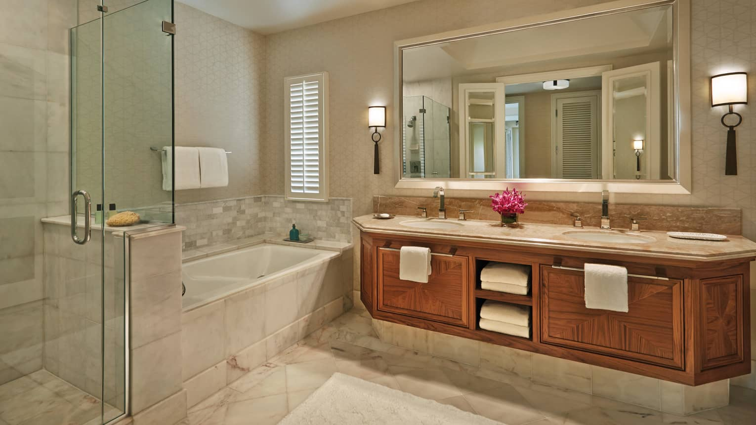 Maile Suite bathroom with double vanity, tub and shower and fresh flowers on the counter