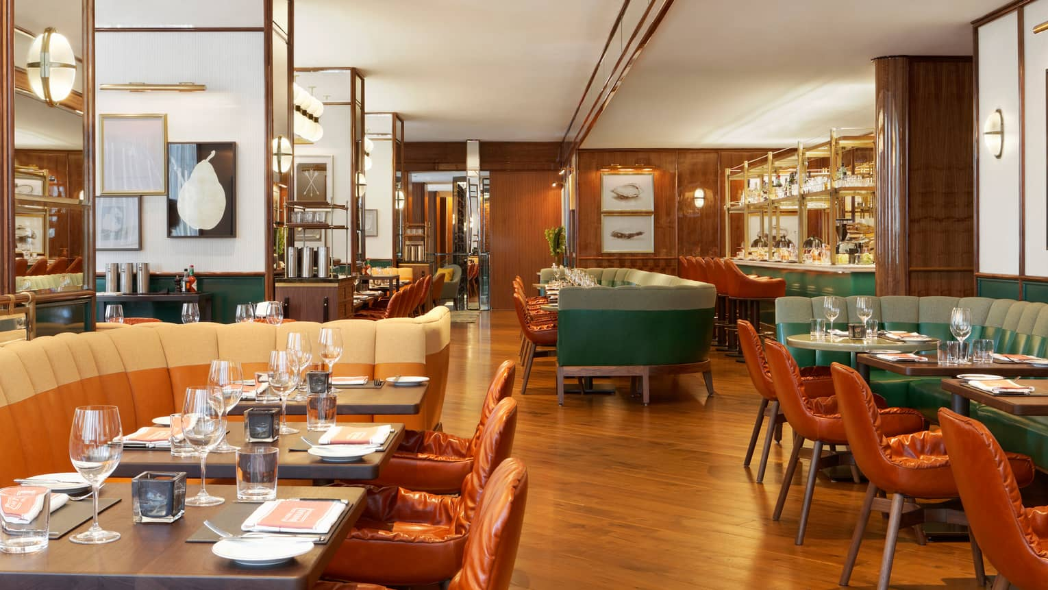 Cafe Boulud dining room with leather chairs, banquettes, sunny dining room