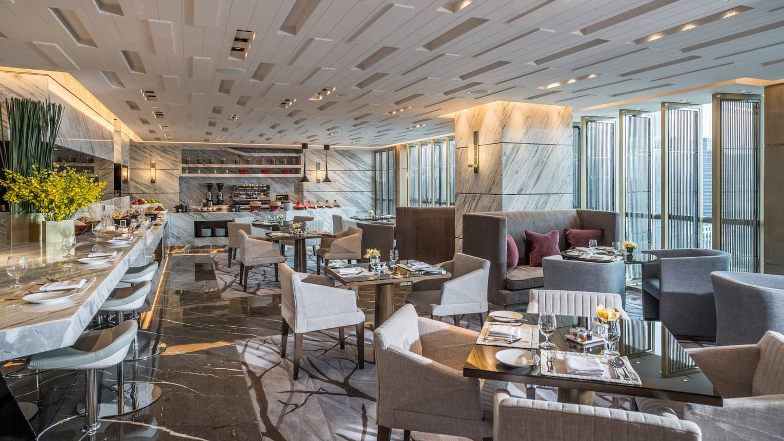 Executive Club Lounge modern dining room with decorative white ceilings, marble bar