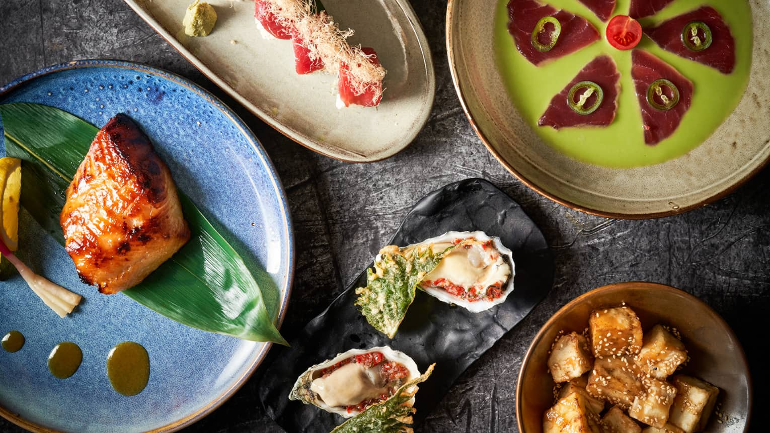 Closeup of five colourful Asian-inspired dishes