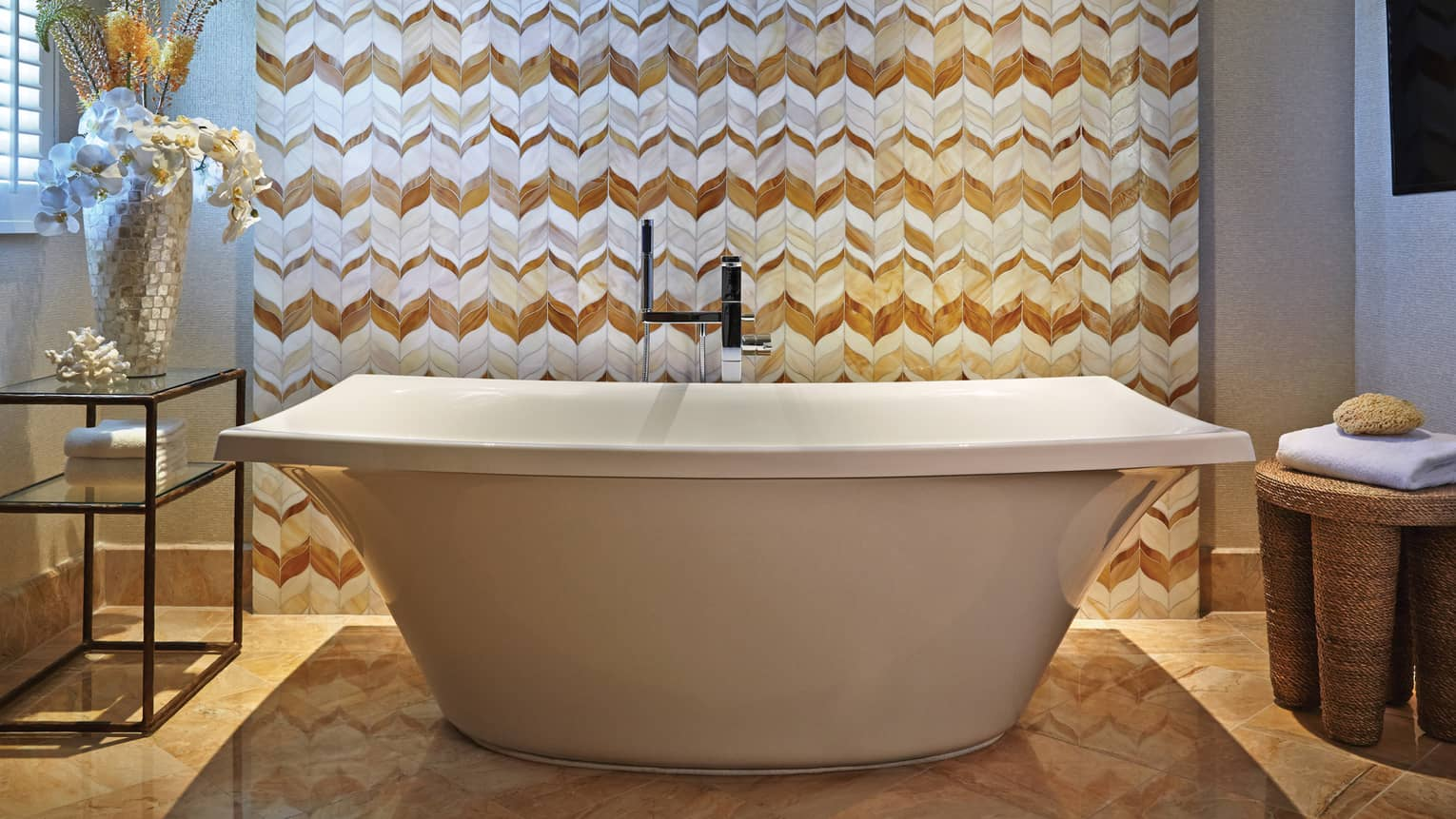 Maile Suite master bathroom with freestanding tub and patterned wall