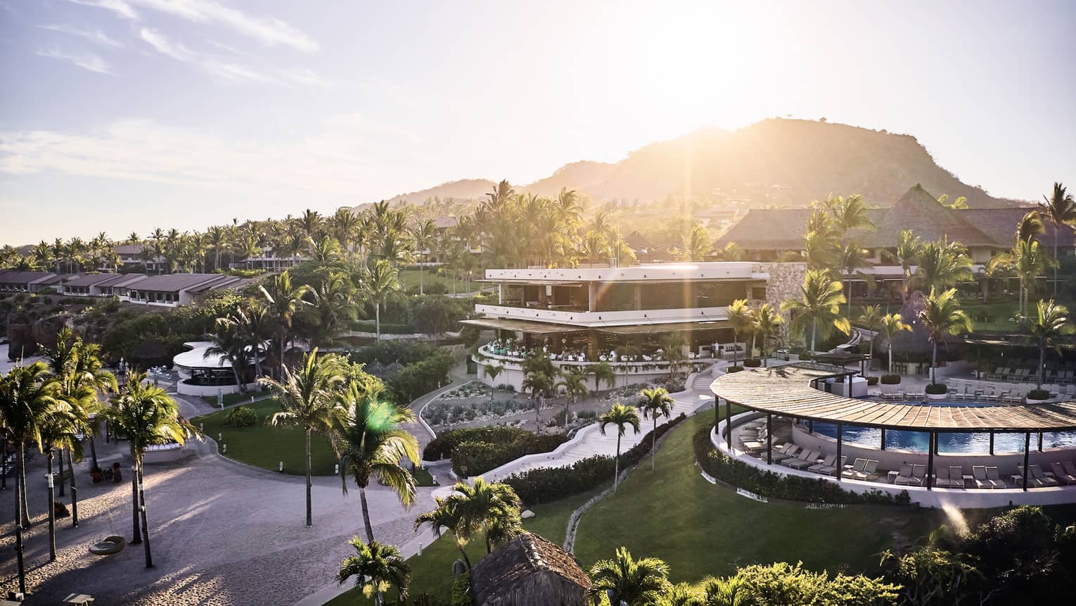 Sun sets over sweeping Four Seasons Resort Punta Mita, mountains
