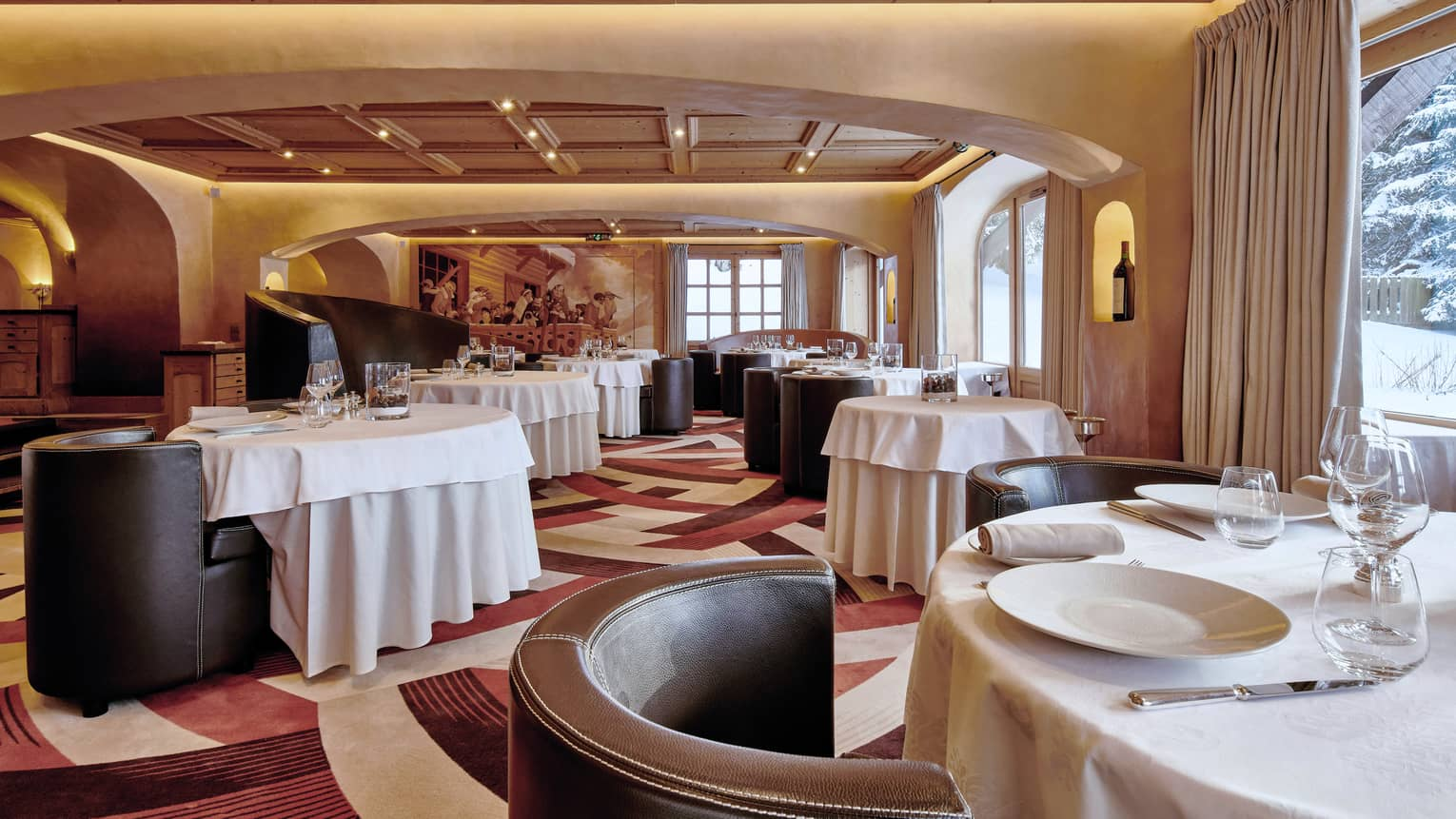 Prima Restaurant, curved leather lounge chairs, dining tables with white linens