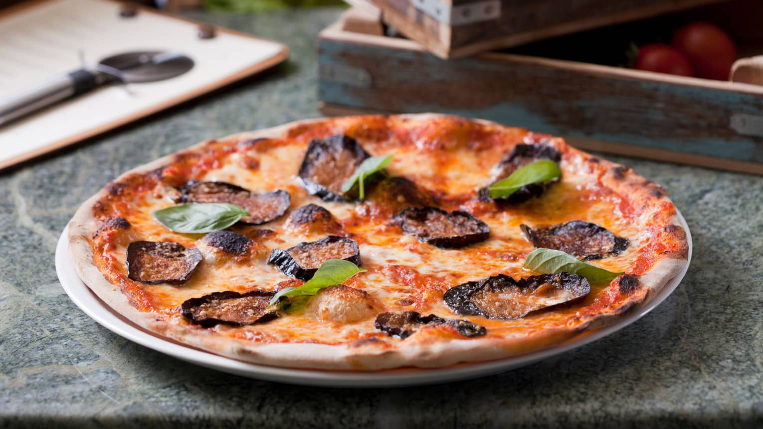 Crispy, thin-crust wood-fired pizza on plate