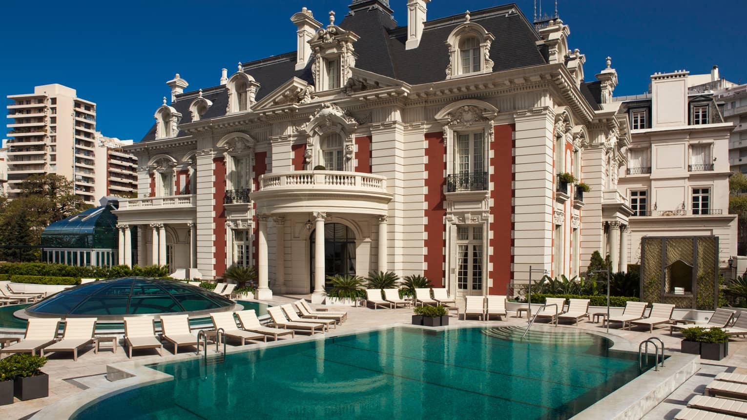 Exterior view of Four Seasons Buenos Aires hotel in historic white mansion with swimming pool