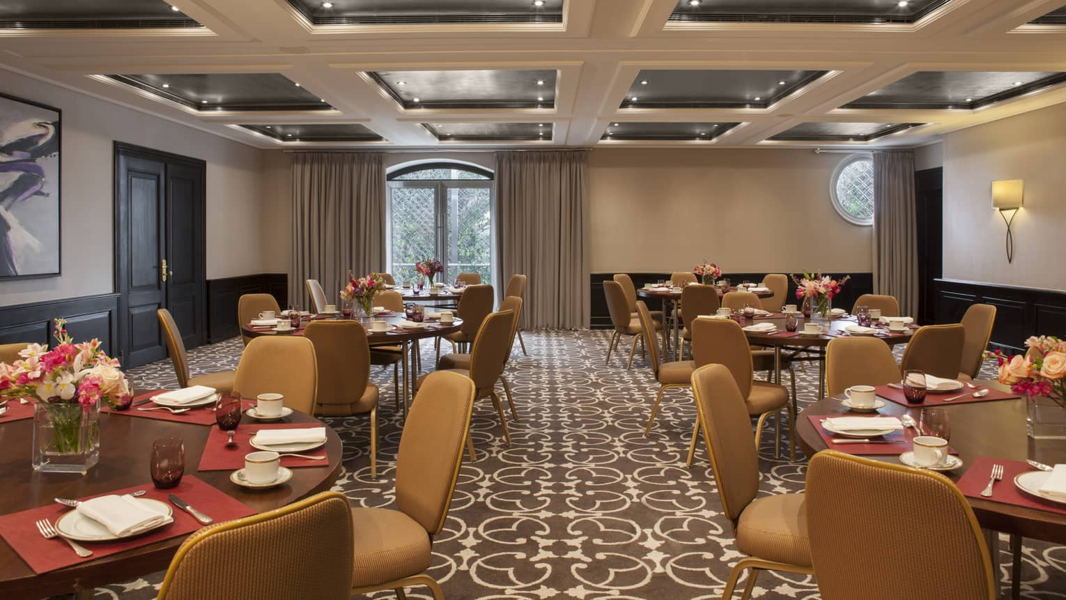 Blas Meeting Room round tables with tan chairs, panel ceiling
