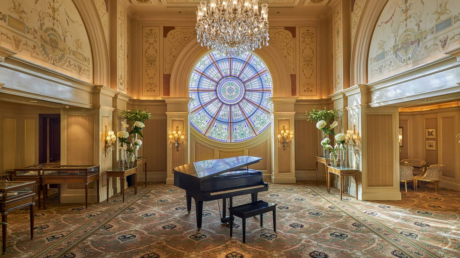 Piano in the Tea Lounge with stained-glass window, the Ocular, in background