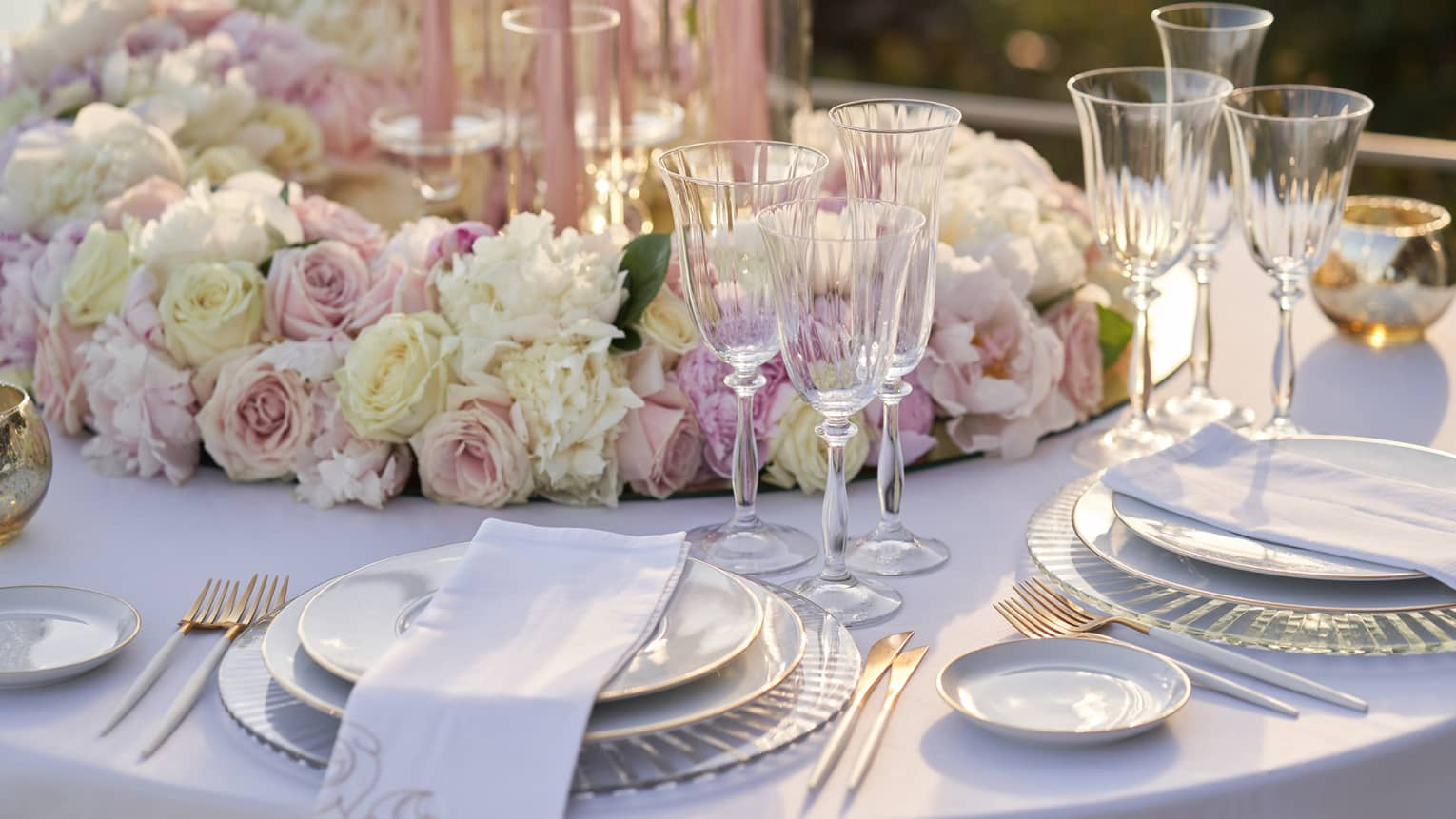 Elegant wedding table place setting with white and pink roses at Club Dauphin
