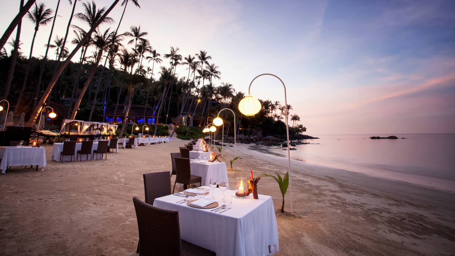 Barbecue on the beach with dining tables on the sand