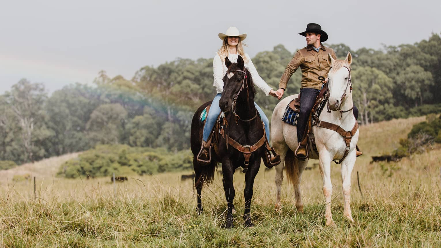 Couple rides horses in Maui at Piiholo Ranch