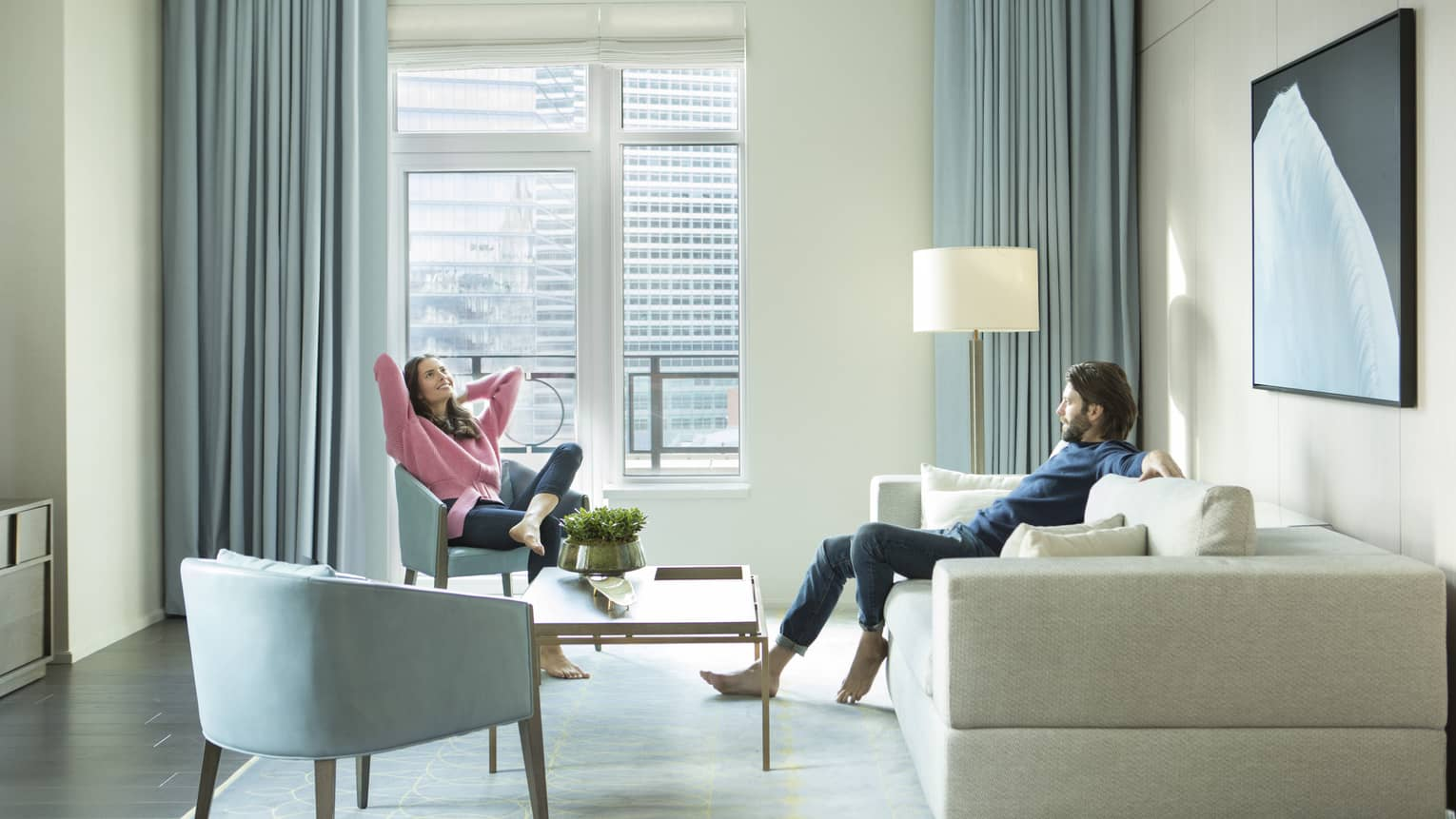 Man and woman relax in guest suite