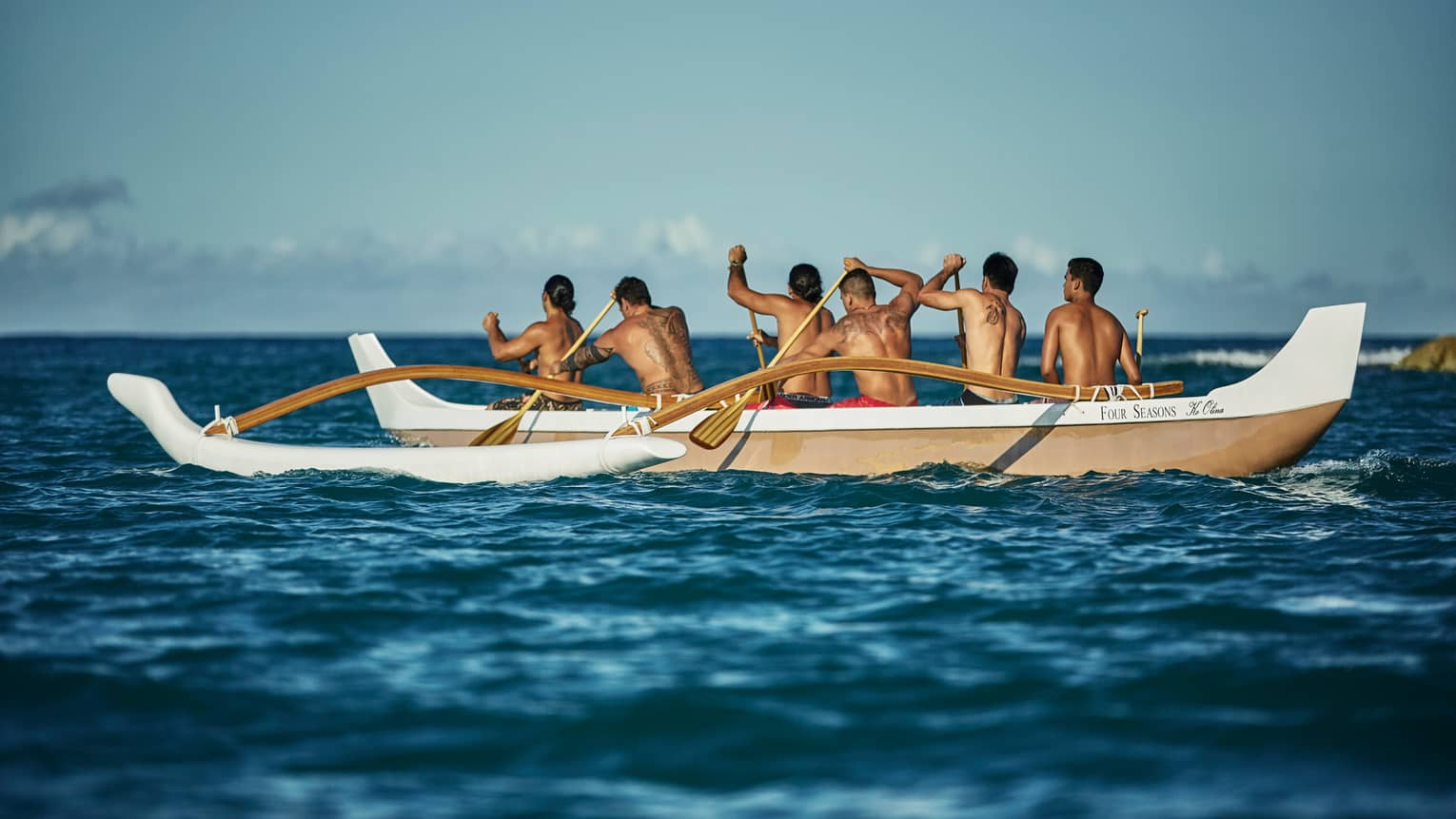 A group of native Hawaiian men out on the ocean in a wayfinding boat