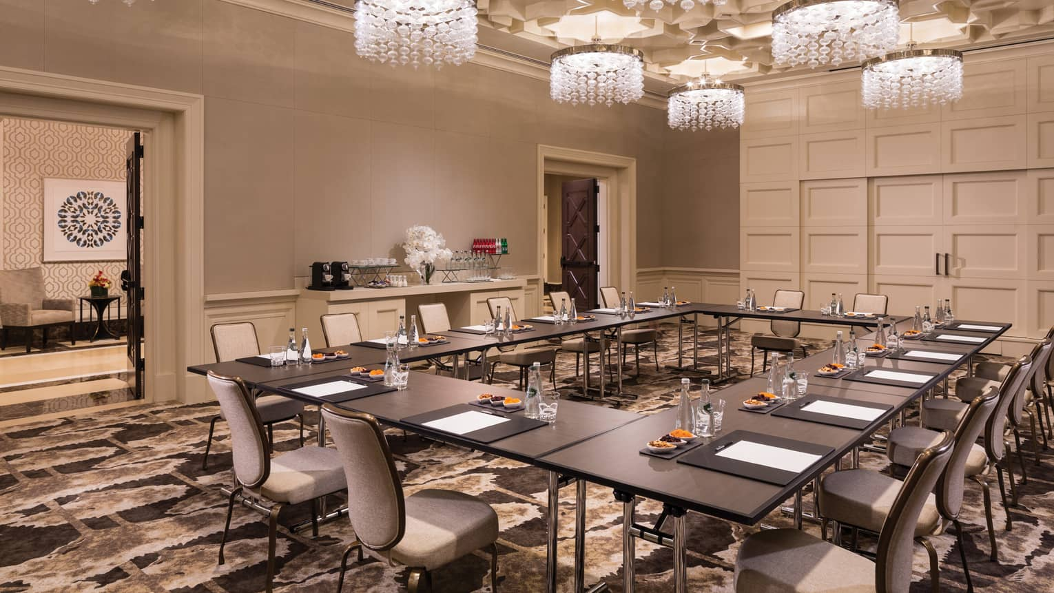 Fox Tail Hollow room with modular meeting table under small crystal chandeliers