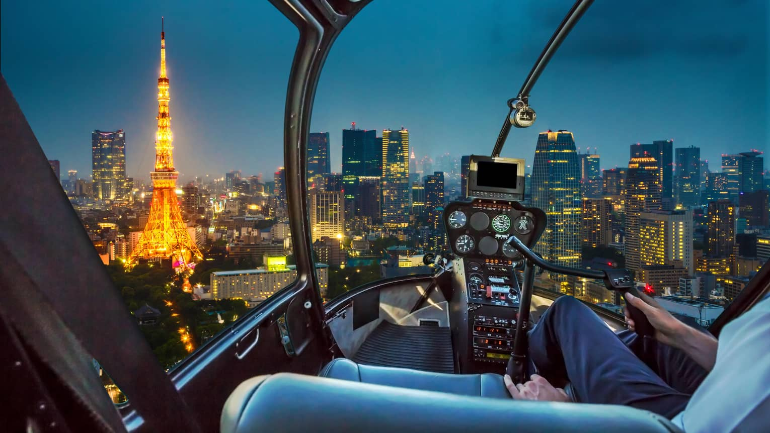 Helicopter looks over Tokyo city at night, Tokyo Tower with lights