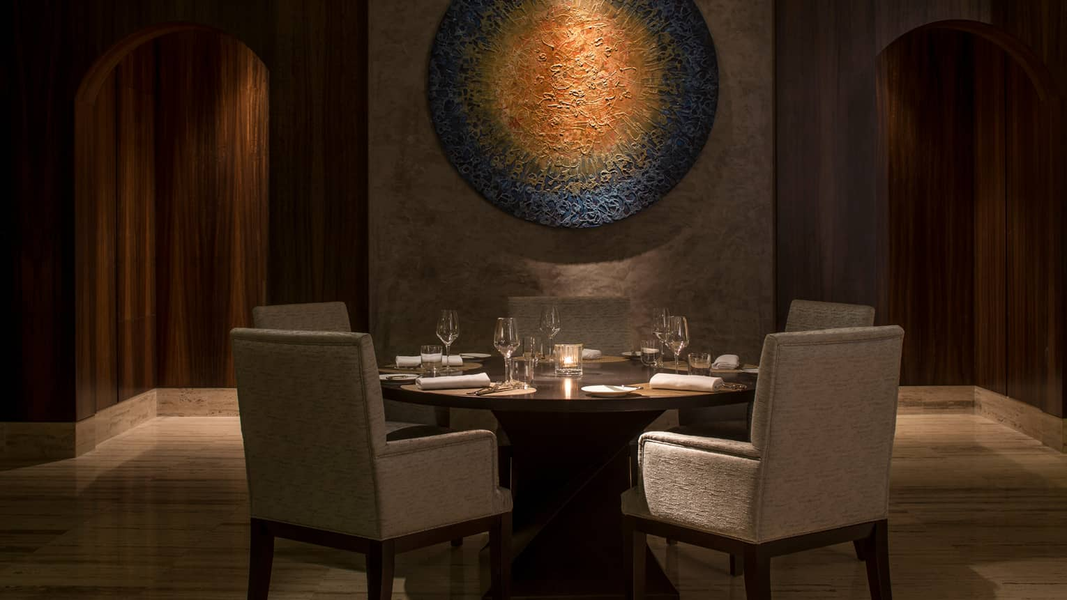 The Creek Restaurant Dining Table, Chairs Under Modern Round Art Sculpture  In Dimly Lit