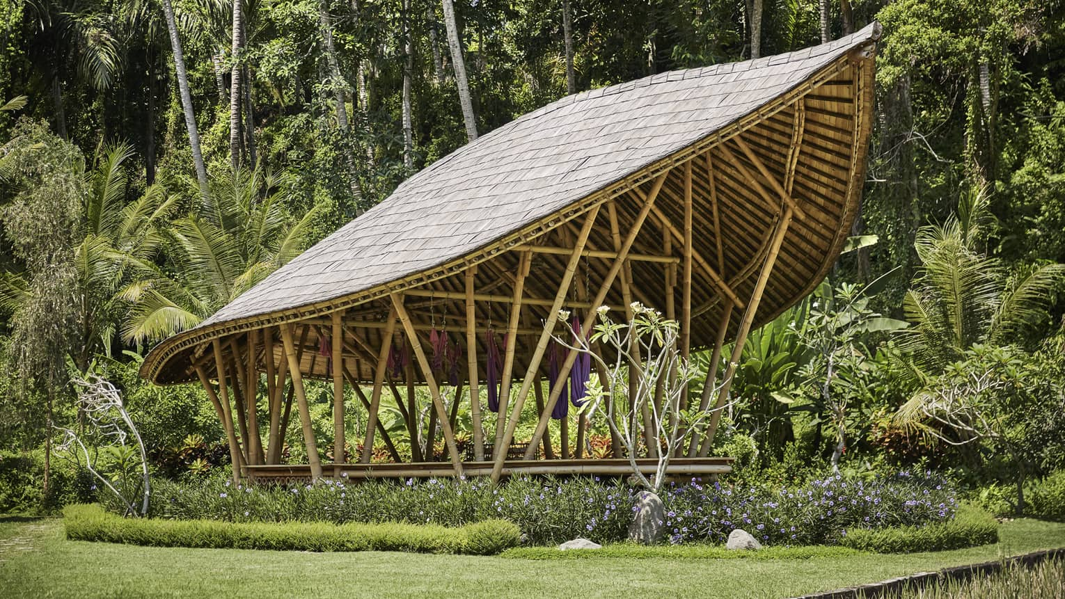 Dharma Shanti Bale leaf-shaped pavilion in tropical garden
