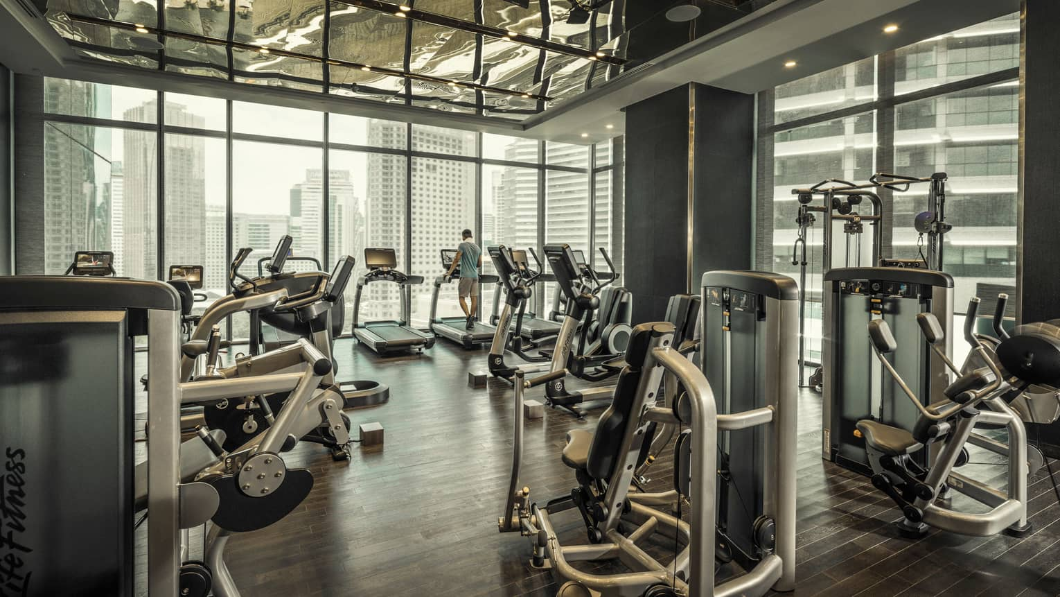 Fitness centre that looks out on the city skyline