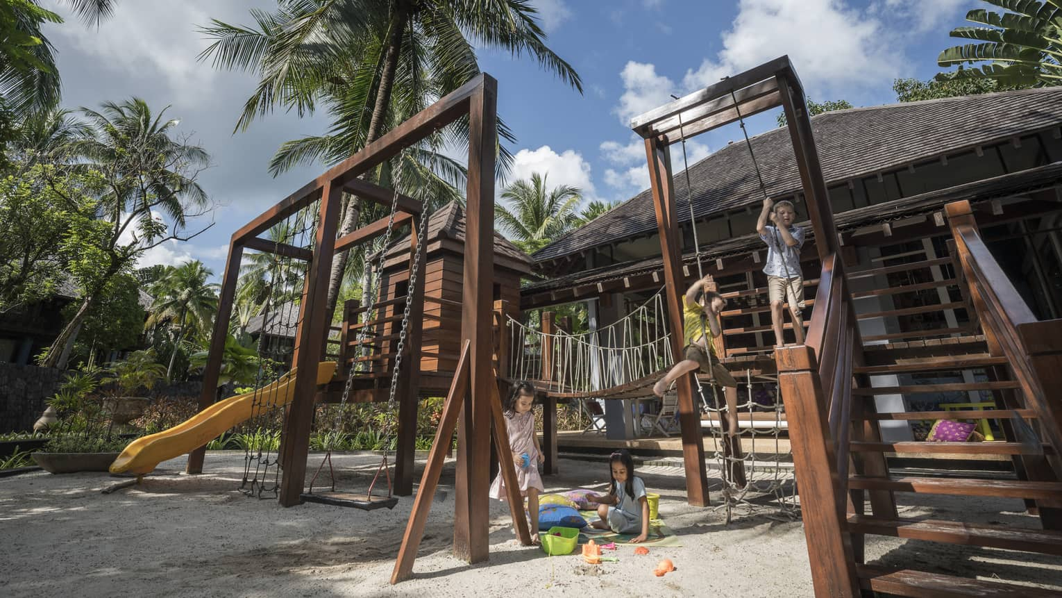 Kids playing on the play set in the kids club at Four Seasons Langkawi