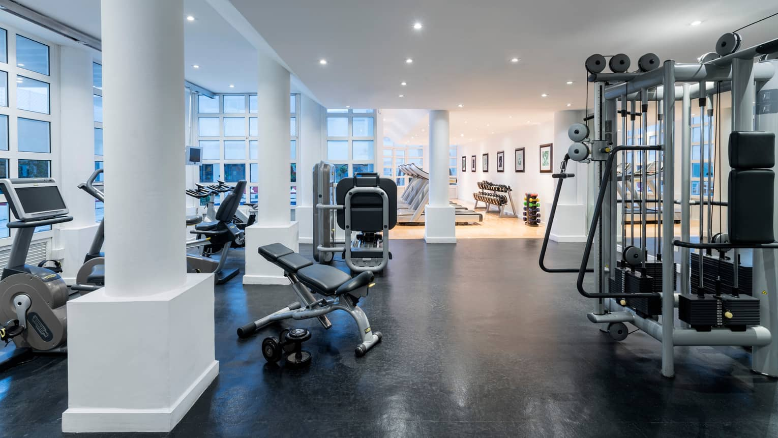 Fitness Centre weights and cardio machines by white pillars