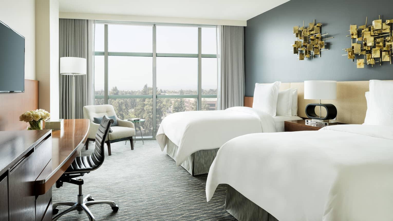 Deluxe Room Double Beds Under Modern Gold Art Desk Tv Armchair By Window