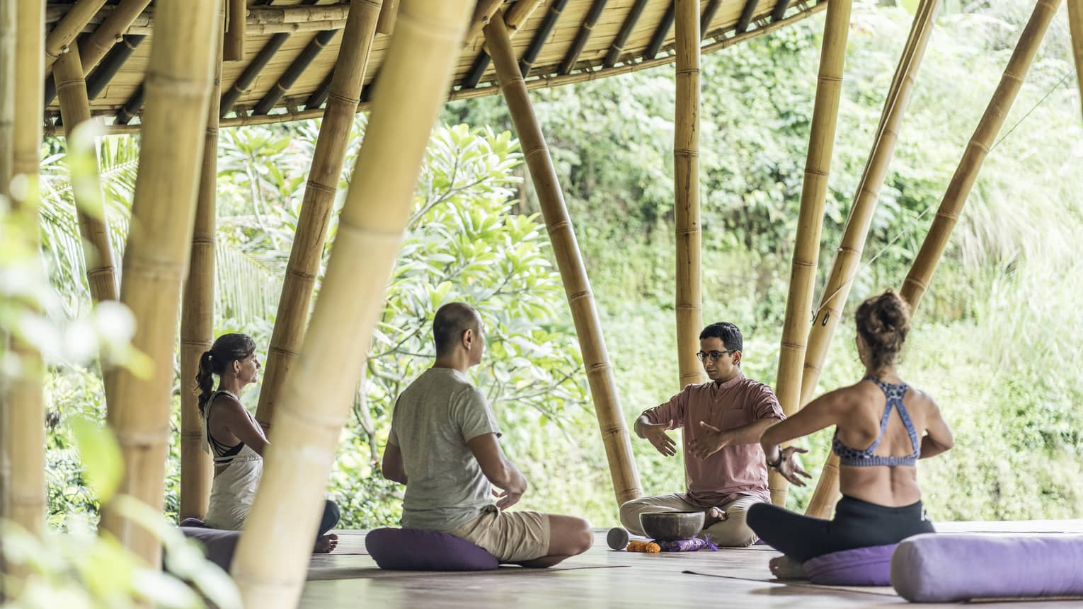 Guests participating in a breath work class in Bali