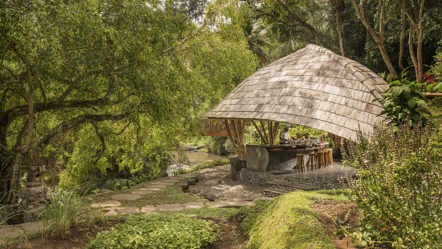 Four Seasons guests attend Sokasi Cooking School in an outdoor pavillion