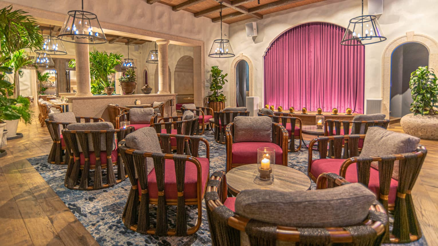 Maximón restaurant's indoor lounge seating and Spanish-inspired archways and pillars.