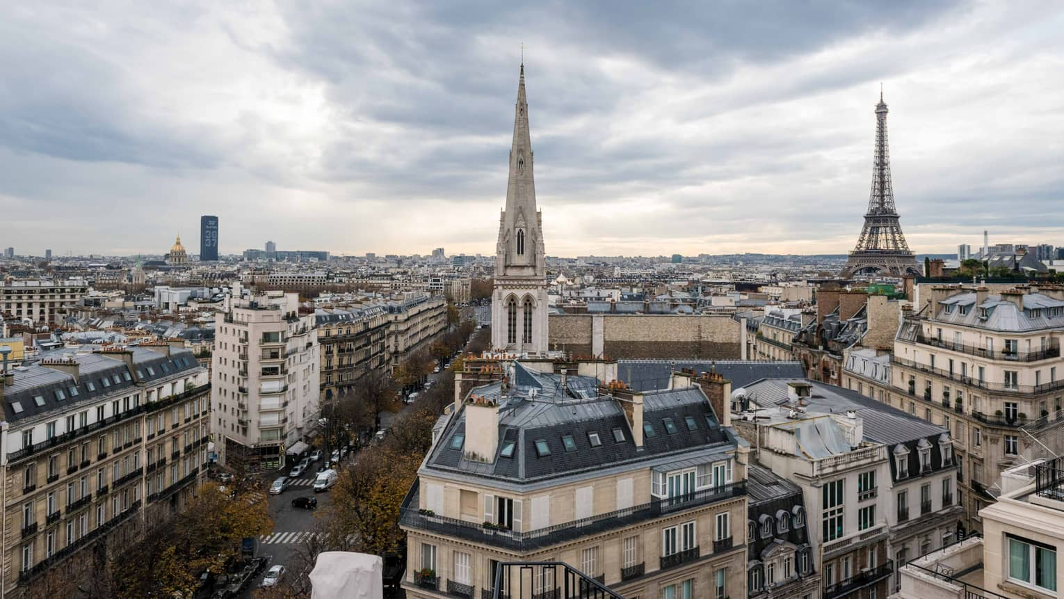 View over Paris's Golden Triangle rooftops, cathedral towers, Eiffel Tower