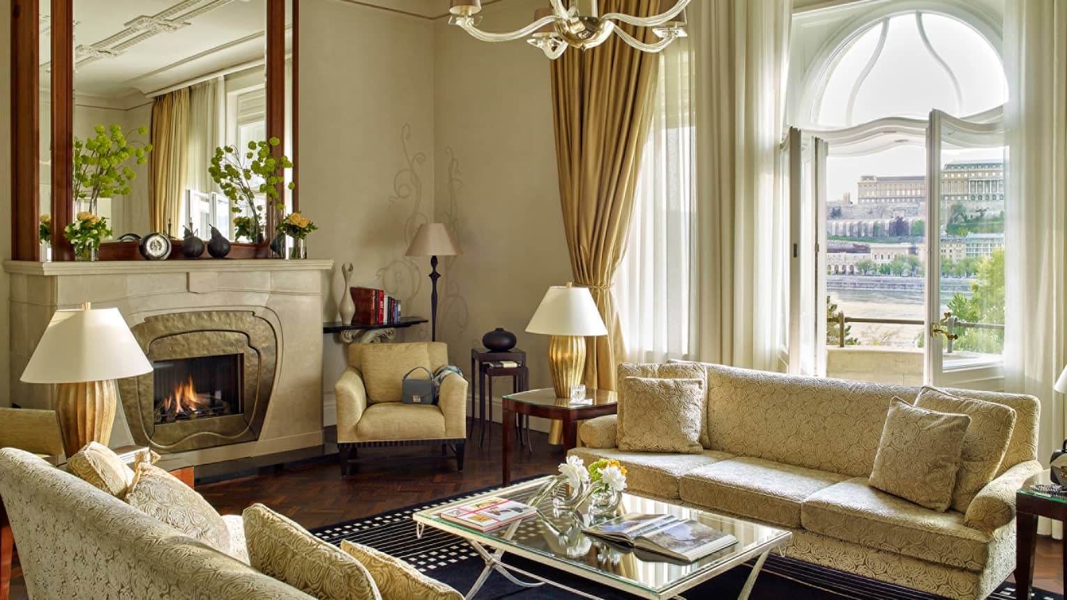 Sir Gresham Presidential Suite velvet sofa with ivory roses by fireplace with large mirror above mantel
