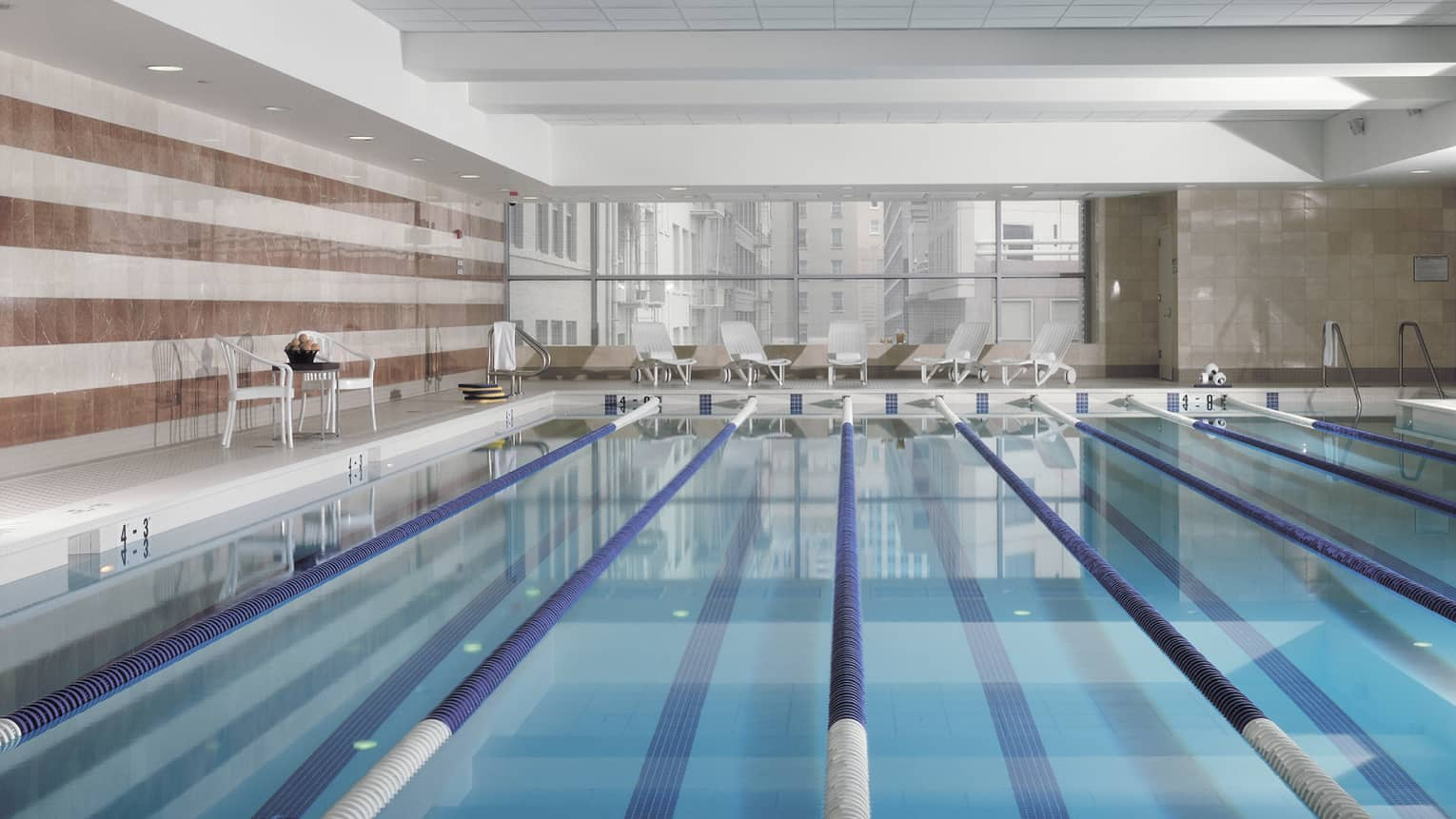 View across indoor swimming pool with divided lanes