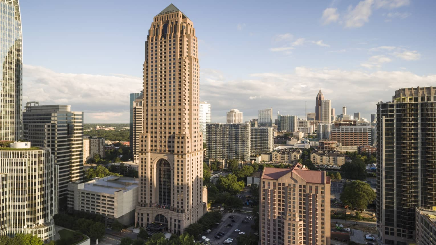 Four Seasons Hotel Atlanta building towering over Midtown on sunny day