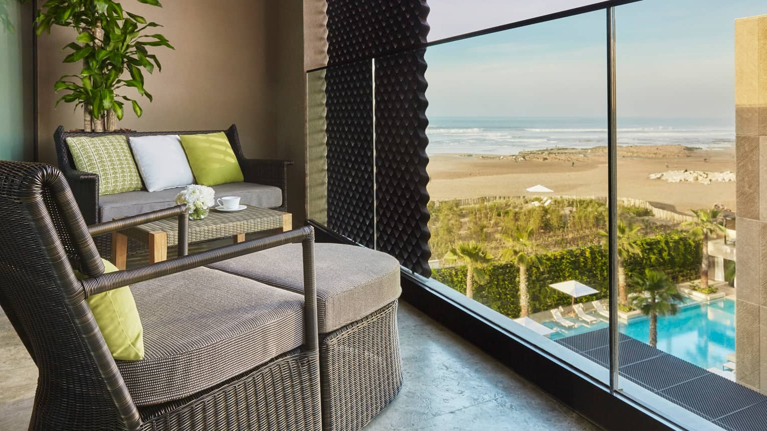 Premier Room balcony large wicker chairs with cushions, lime green accent pillows, beach views