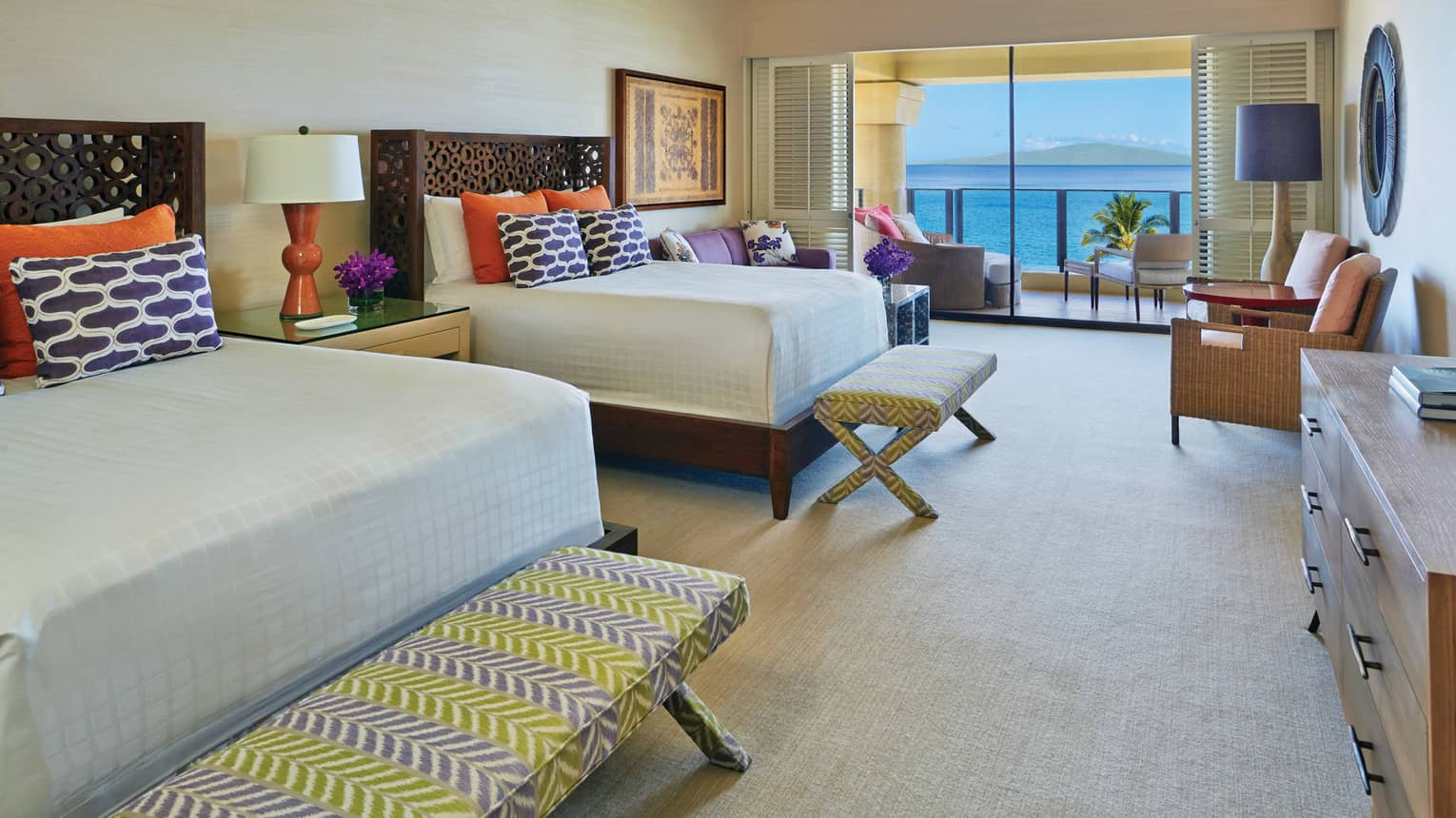 Maile Suite double bedroom with view onto the ocean and colourful bedding