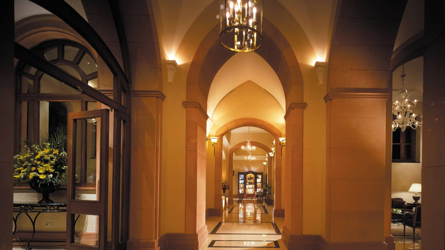 Pinched arches in elegant, dimly-lit hotel lobby