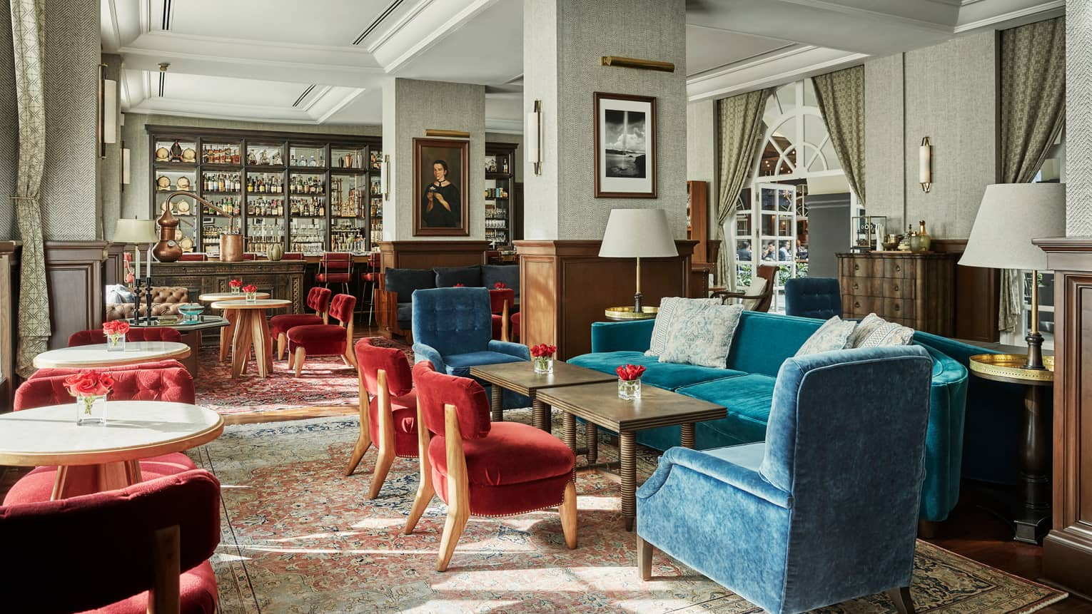 Fifty Mils dining room, red, blue velvet chairs and tables, arched windows, bar, oil portrait