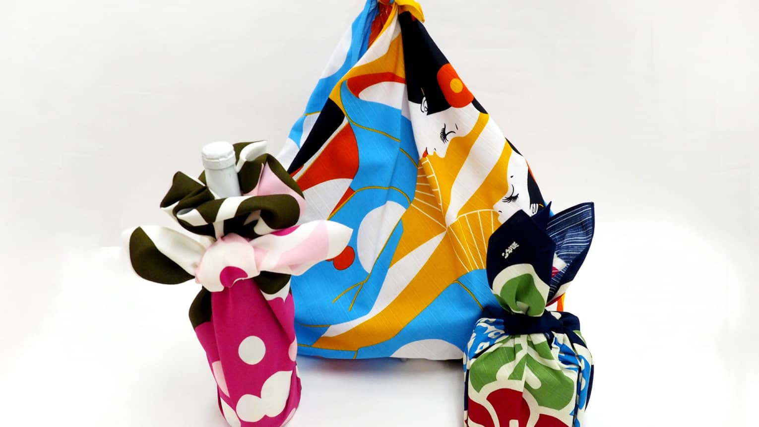 Close-up of bottle, items wrapped in colourful Furoshiki cloth