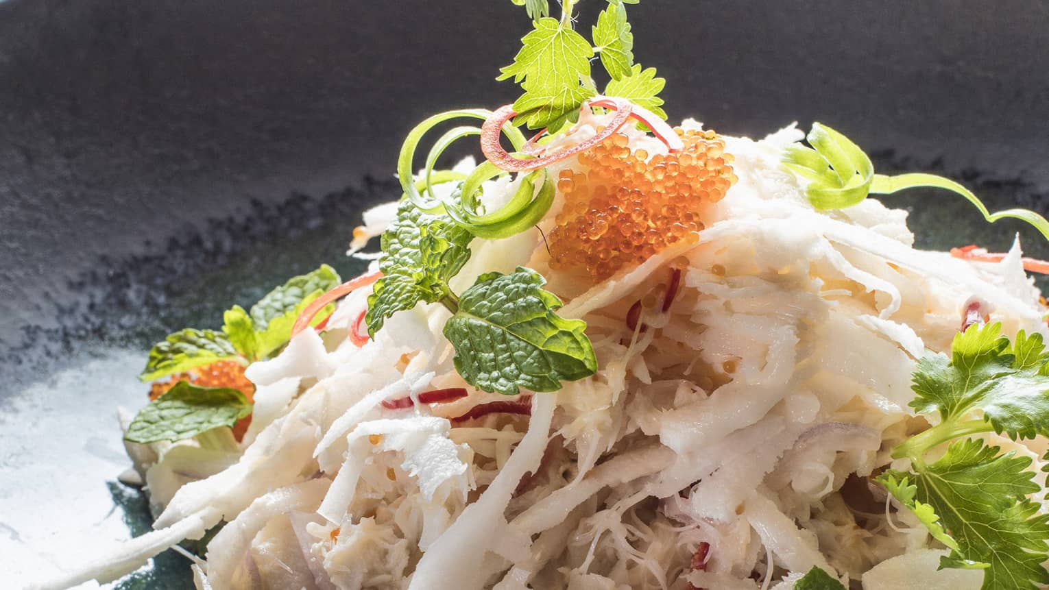 Sundara crab with Asian herbs, grated coconut and lime palm sugar dressing