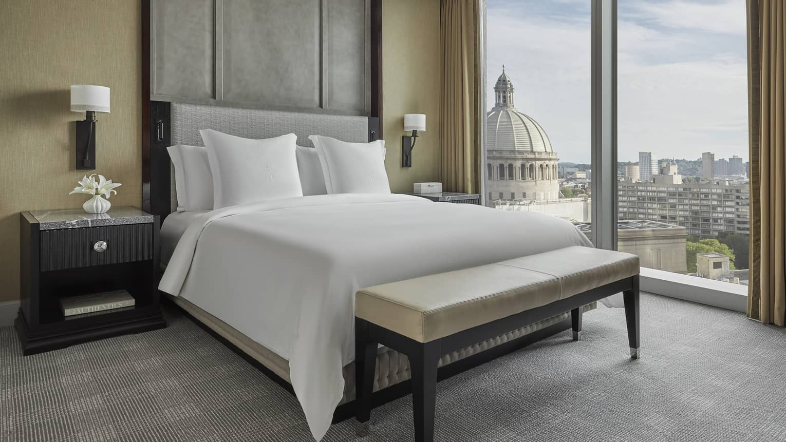 the floor to ceiling windows in the Executive Suite overlook downtown boston