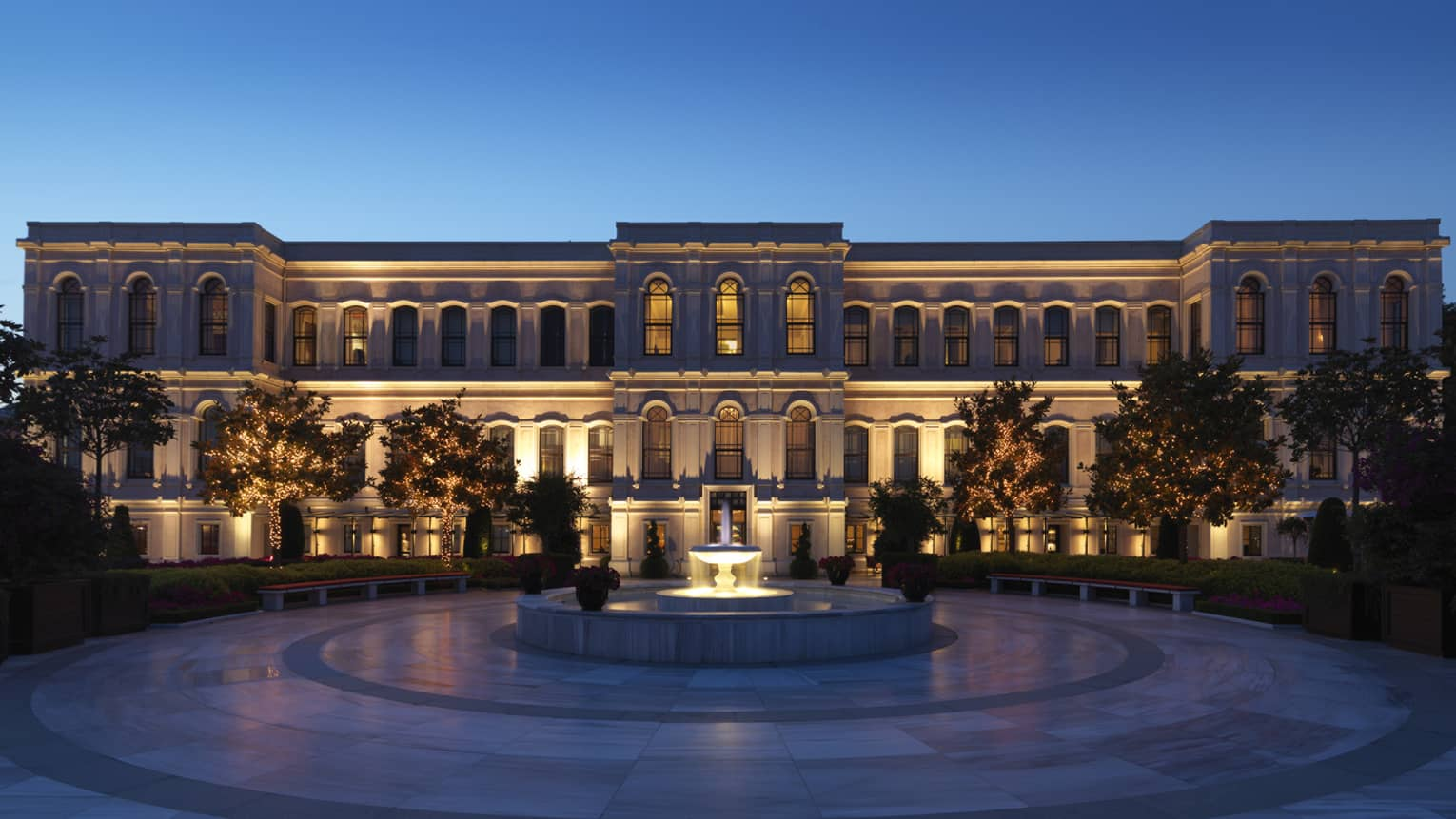 Four Seasons hotel Istanbul at the Bosphorus building exterior, fountain with lights at dusk