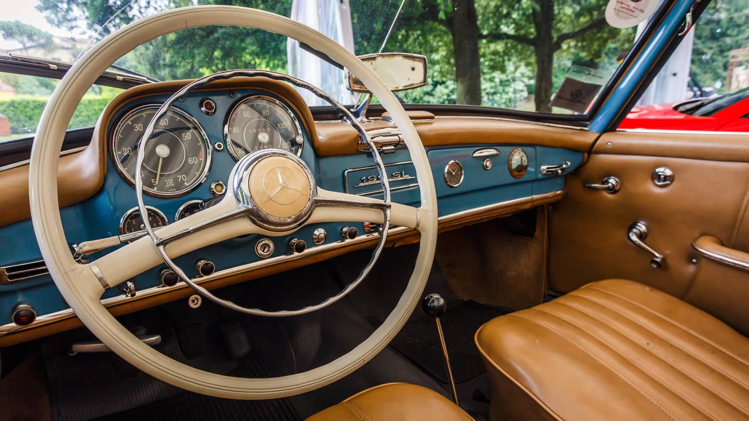 Wheel, dashboard, leather seats of classic luxury car