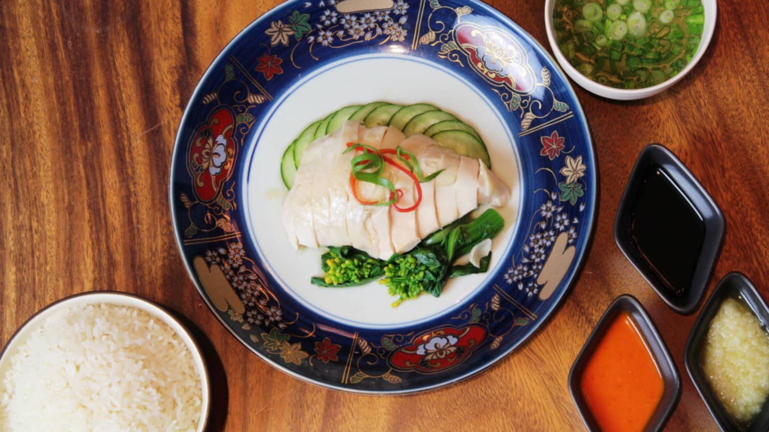 Aerial view of Hainanese Chicken Rice on decorative plate