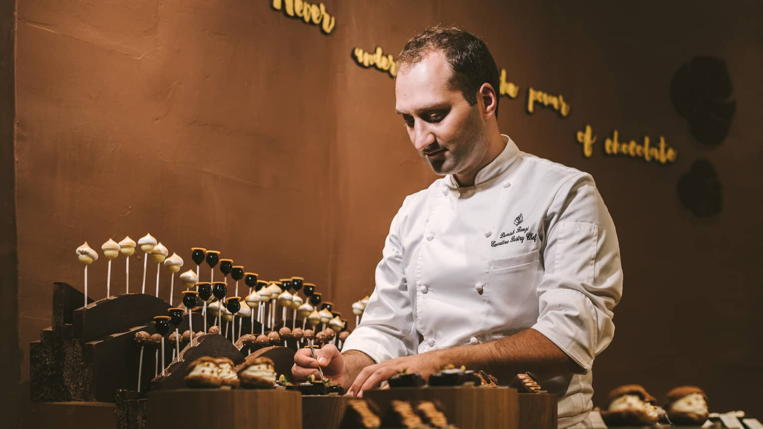 Pastry chef Daniele Bonzi in the chocolate room, entirely decorated in chocolate
